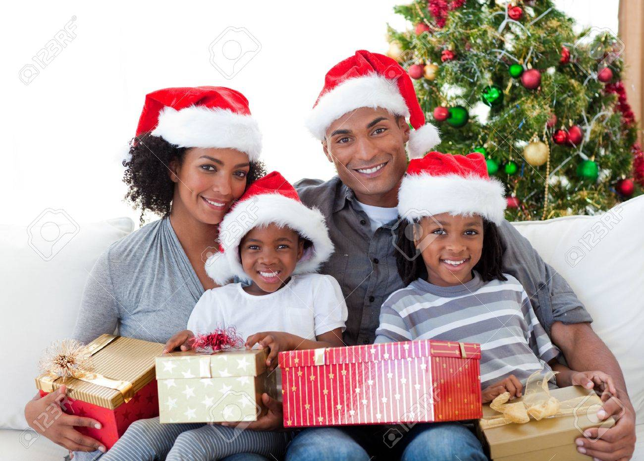 Afro-American family holding Christmas presents Stock Photo - 10249930