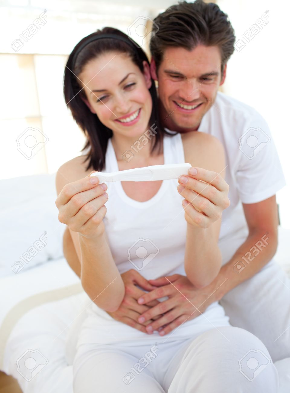 Smiling couple finding out results of a pregnancy test Stock Photo - 10246193