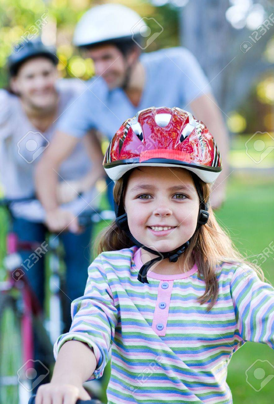 Smiling little girl riding a bike Stock Photo - 10249976