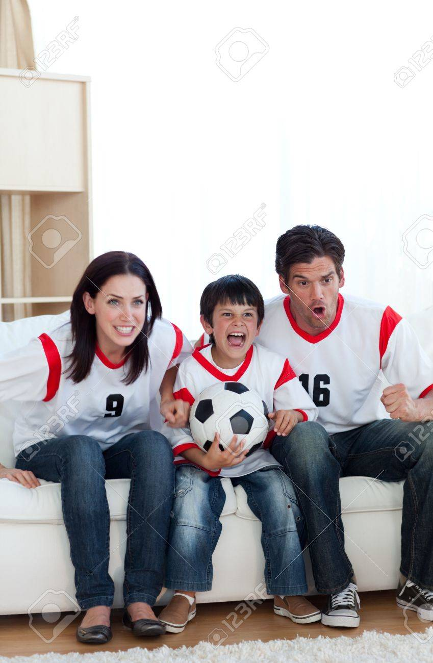 Animated family watching a football match Stock Photo - 10247644