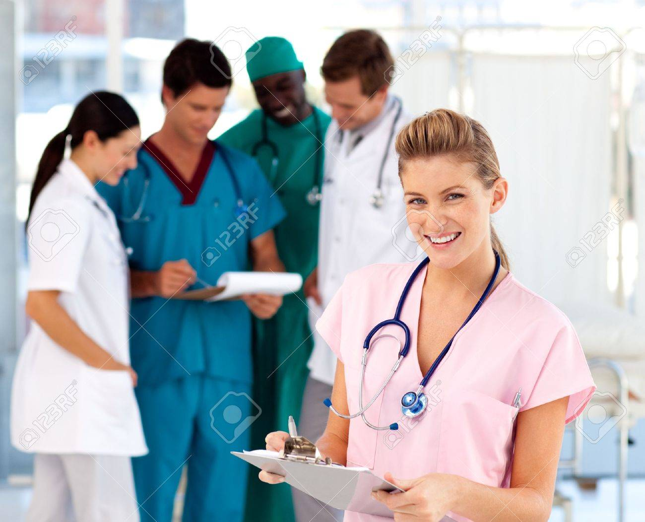 Blonde nurse with her team in the background Stock Photo - 10233802