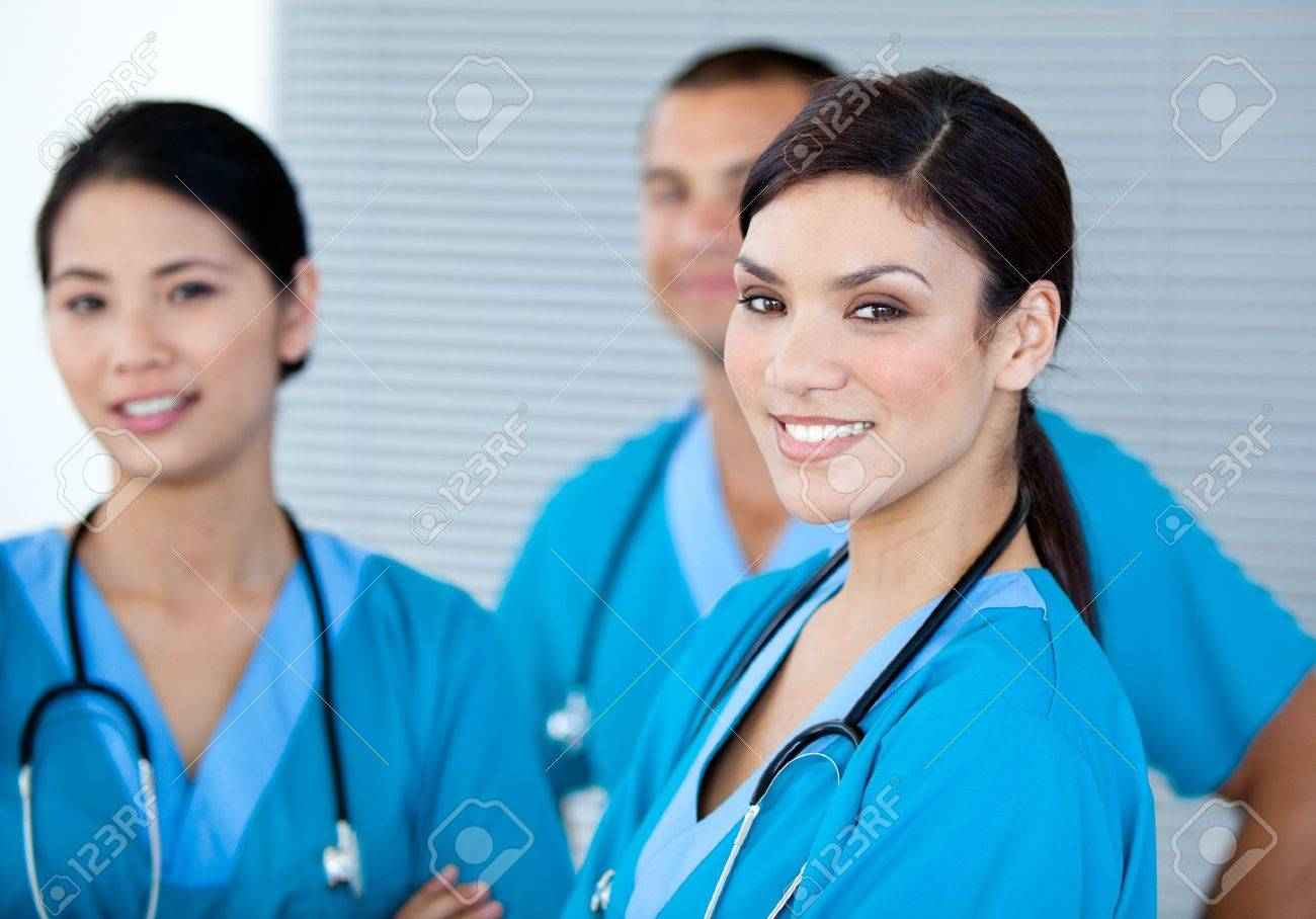 Happy doctor colleagues looking at the camera Stock Photo - 10248021