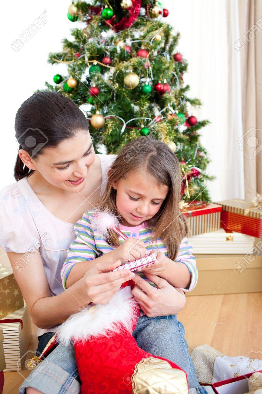 Mother and daughter at home at Christmas time Stock Photo - 10249972