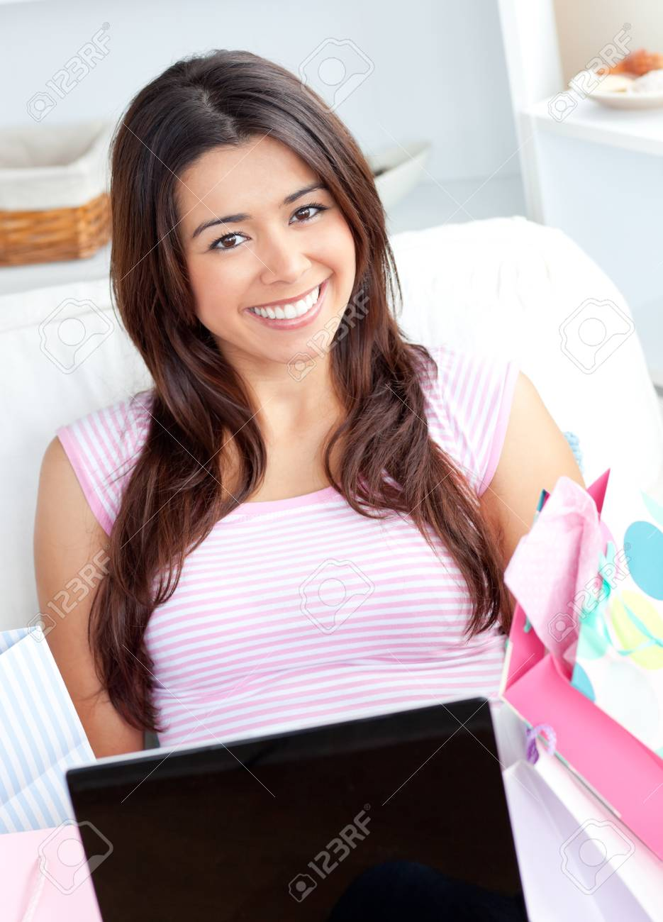Cute young woman is using a laptop Stock Photo - 10250469
