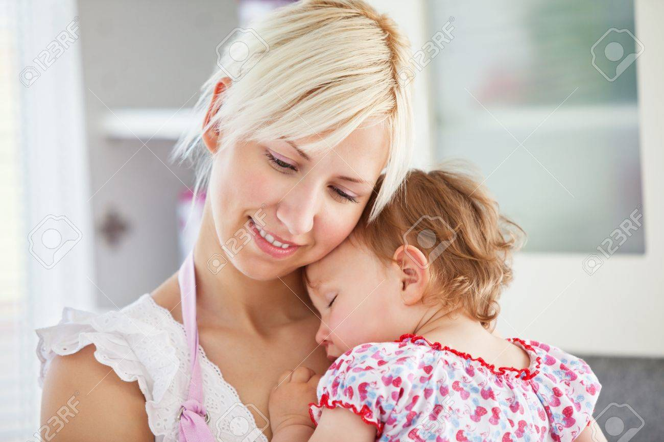 Good-looking mother playing with her daughter Stock Photo - 10250027