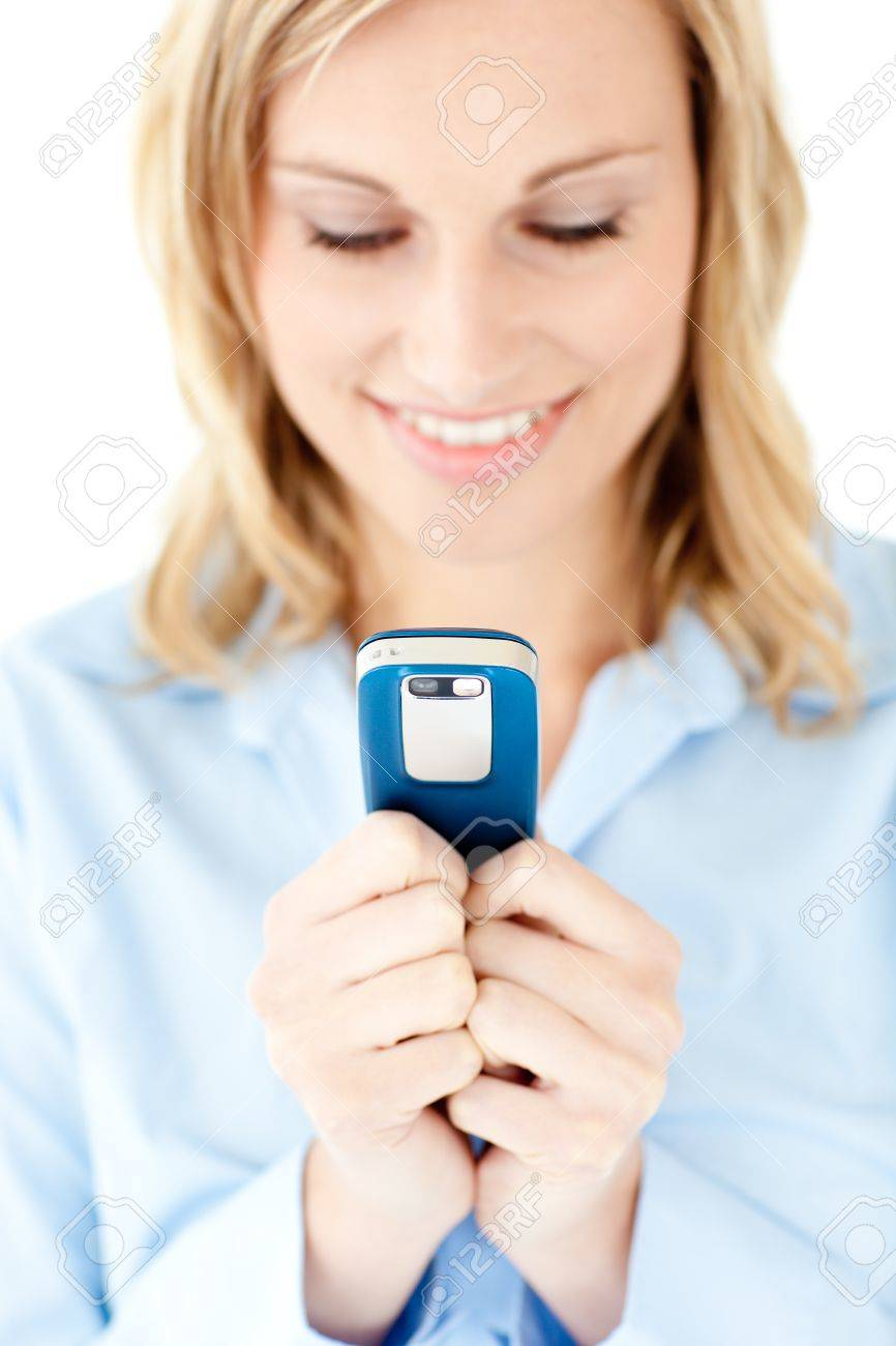Radiant young woman writing a message on her cellphone Stock Photo - 10250115