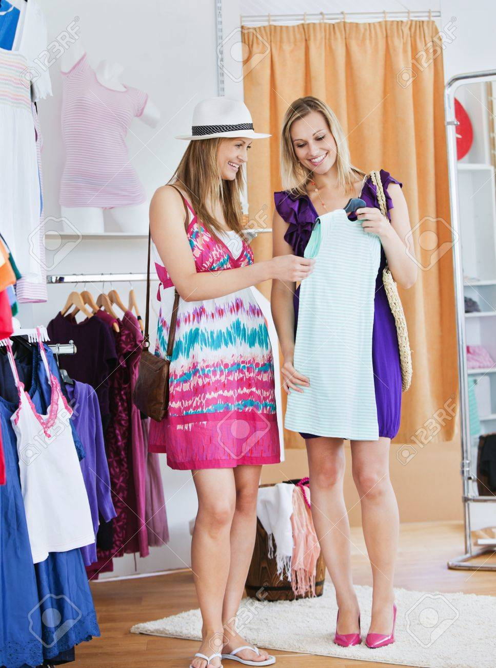 Animated friends looking at a shirt in a clothes store Stock Photo - 10248979