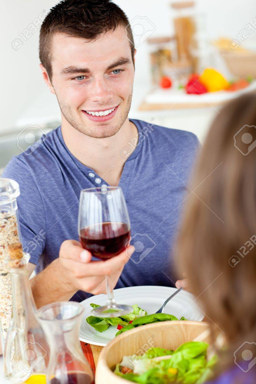 Charming young man having dinner with his girlfriend Stock Photo - 10250134