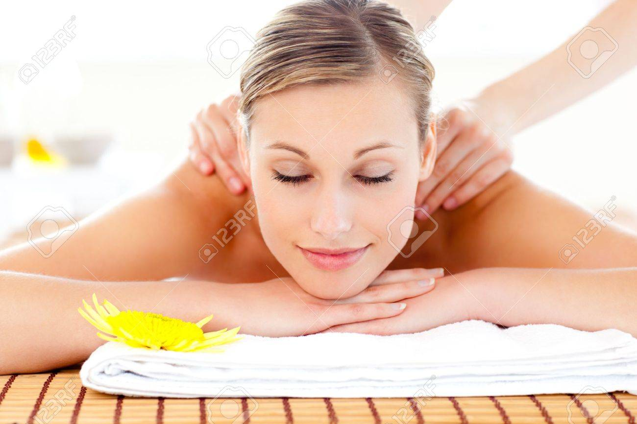 Portrait of a delighted woman lying on a massage table Stock Photo - 10242053