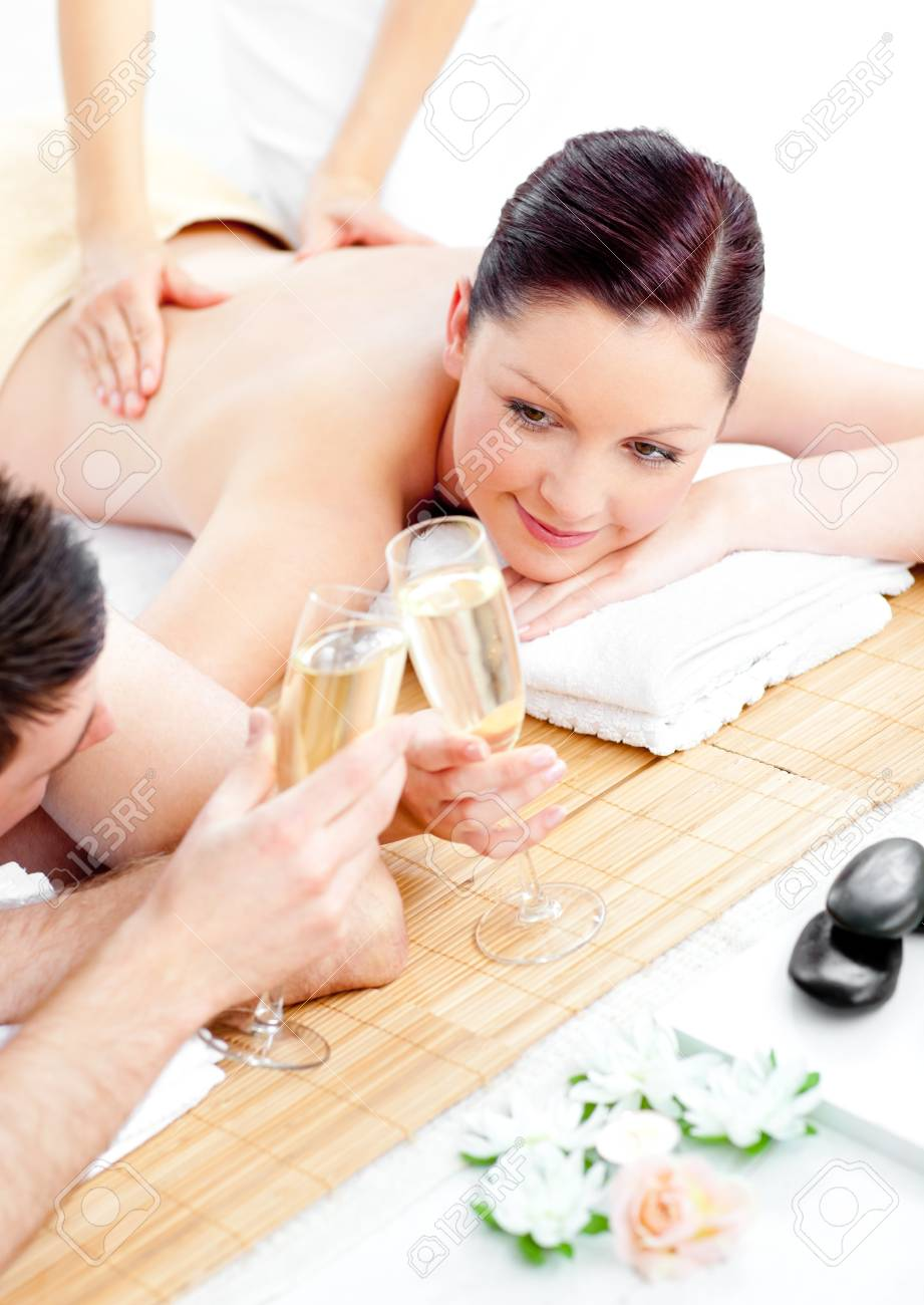 Caucasian young couple enjoying a back massage and drinking champagne Stock Photo - 10242311