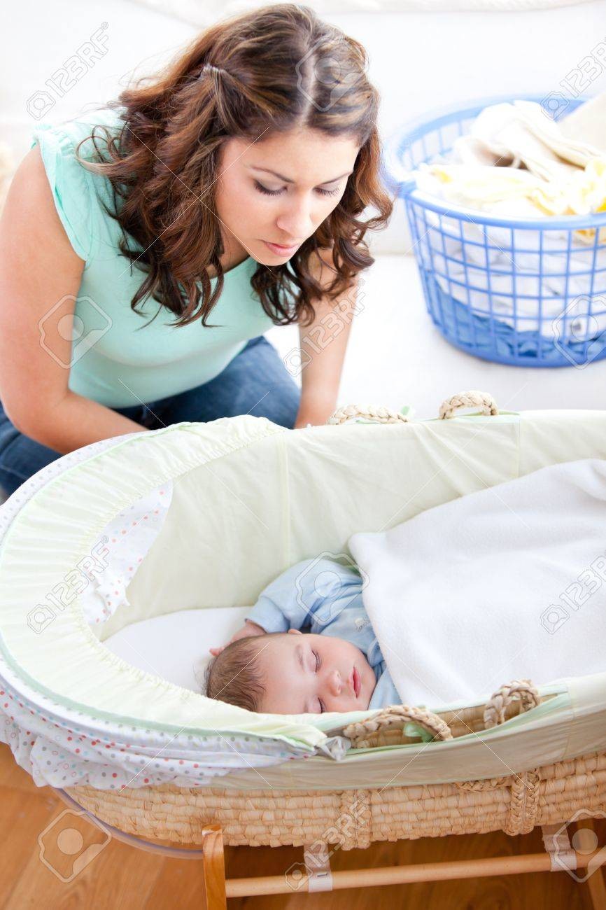 Young mother looking at her little son sleeping in his bed Stock Photo - 10242947