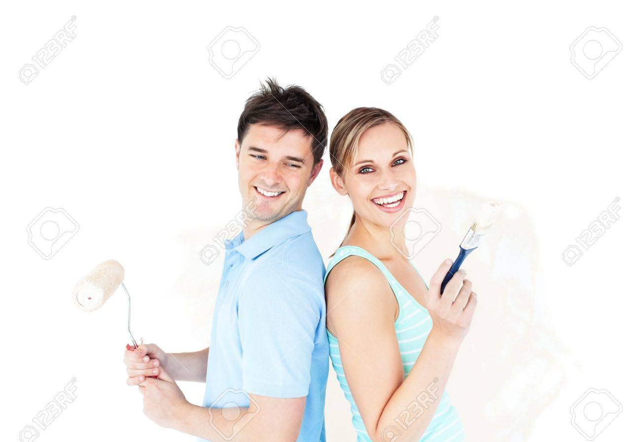 Bright young couple painting a room Stock Photo - 10240979