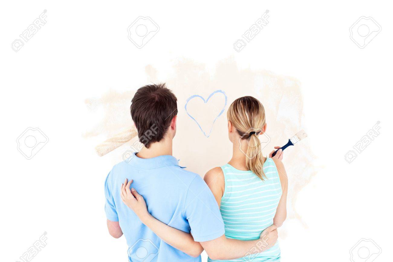 Kind young couple painting a room Stock Photo - 10241178