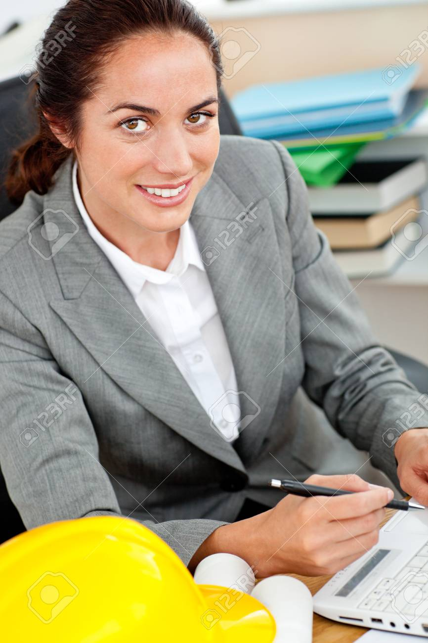 Delighted female architect working in her office Stock Photo - 10243159