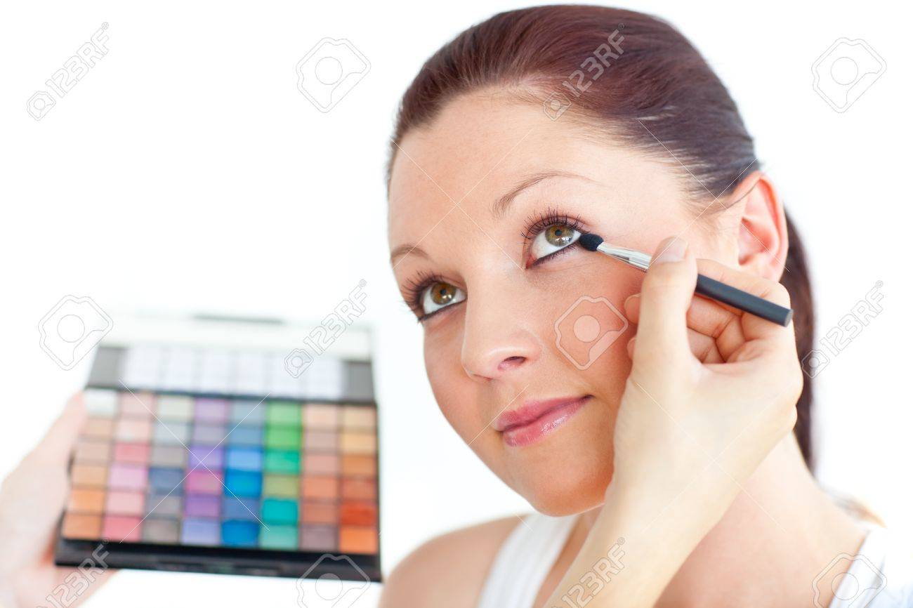 Charming woman being applied eye makeup Stock Photo - 10243610