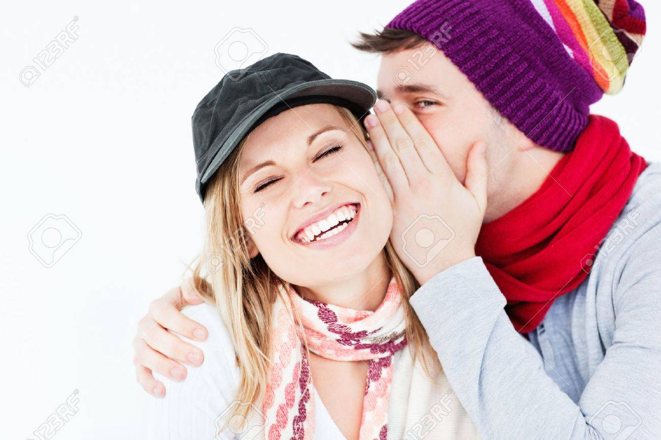 Young couple sharing a secret Stock Photo - 10244263