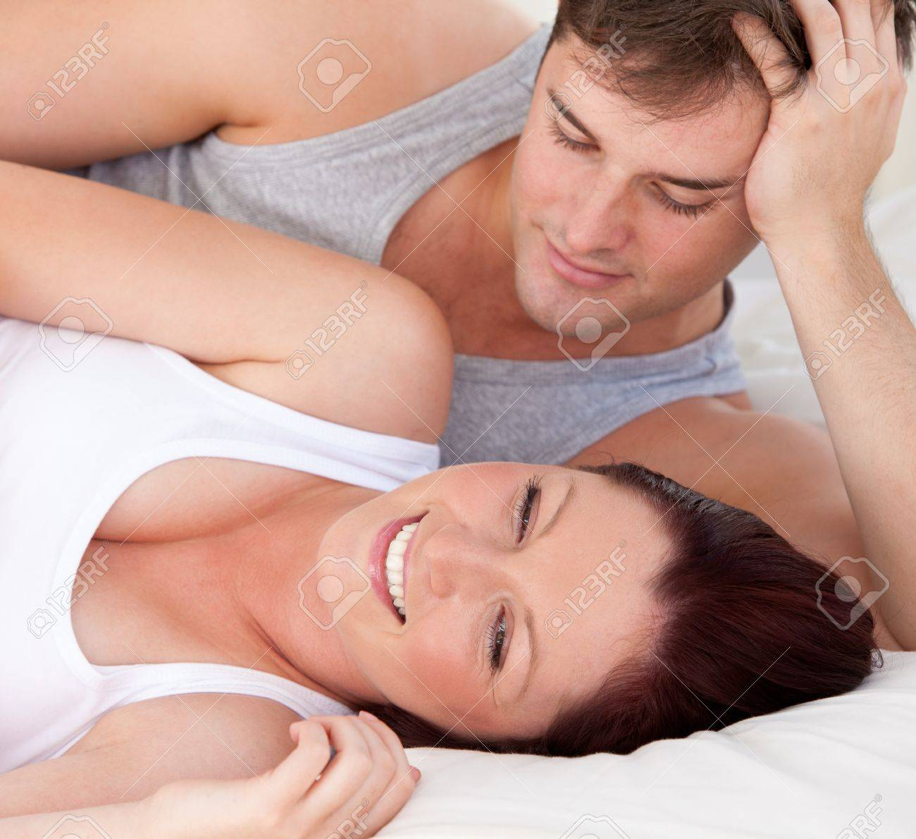 Close-up of an affectionate man looking at his pregnant wife lying on the bed Stock Photo - 10244004