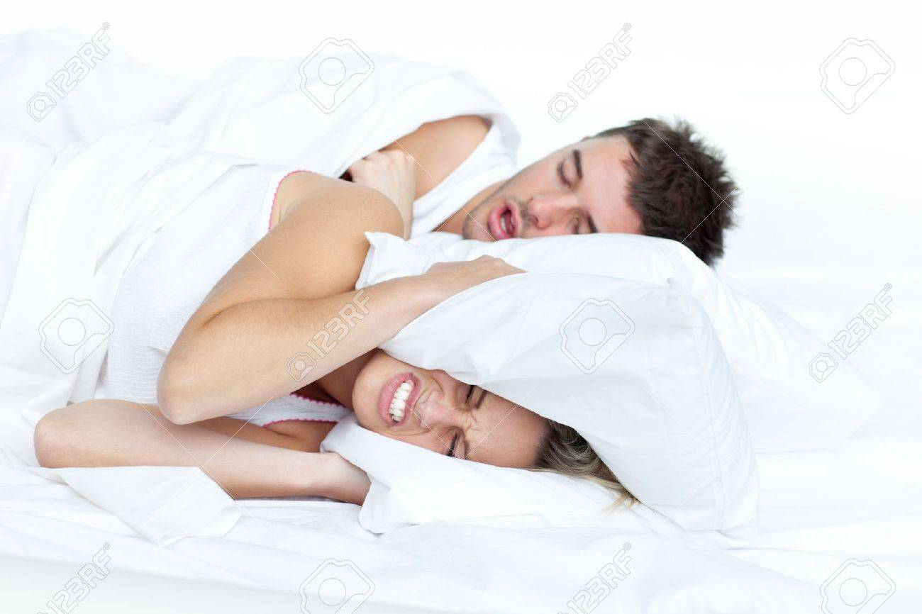 Couple in bed while the woman is trying to sleep Stock Photo - 10243560