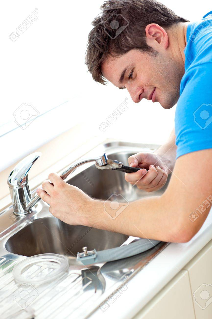 Caucasian man repairing a kitchen sink at home Stock Photo - 10243852