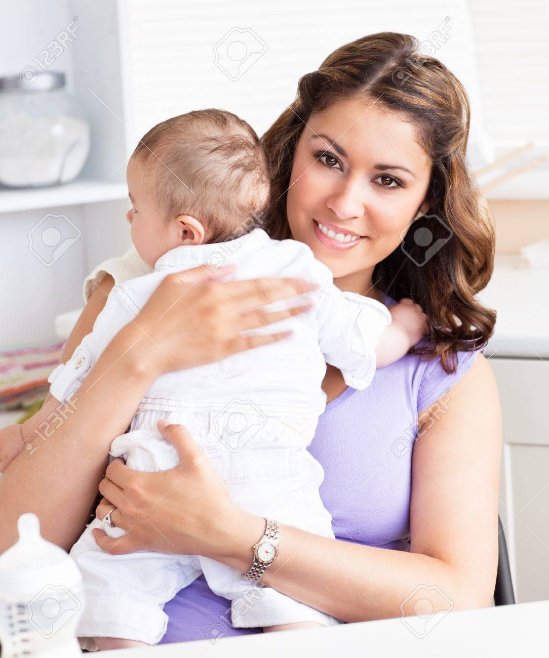 Caucasian young mother taking care of her adorable baby Stock Photo - 10243534