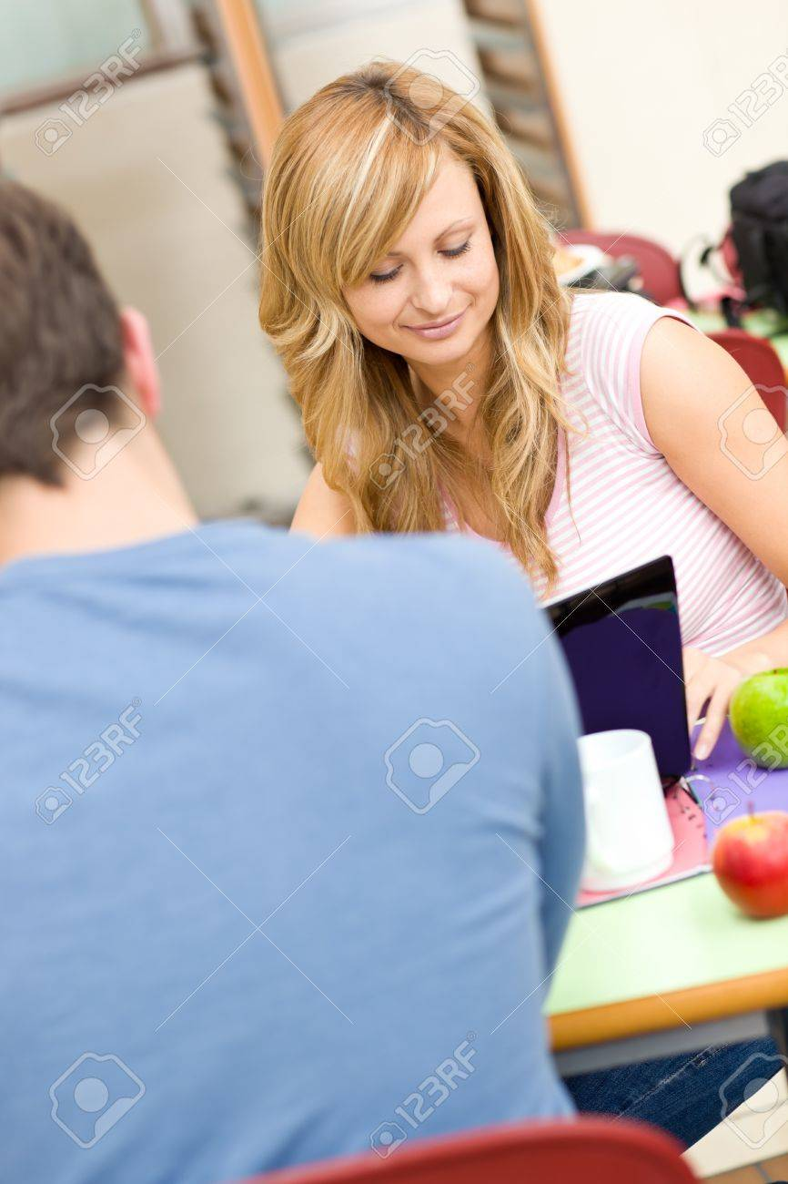 Serious couple of students working together in the cafeteria Stock Photo - 10245131