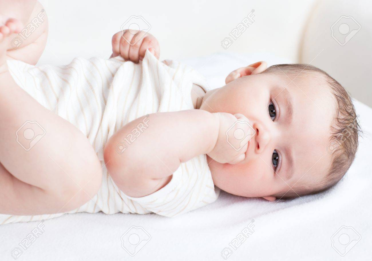 Portrait of a cute newborn baby lying on the sofa in his bedroom Stock Photo - 10244978
