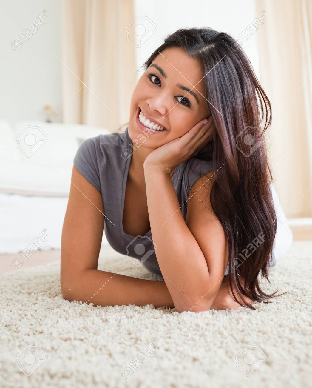 charming woman lying on a carpet in livingroom Stock Photo - 11191900