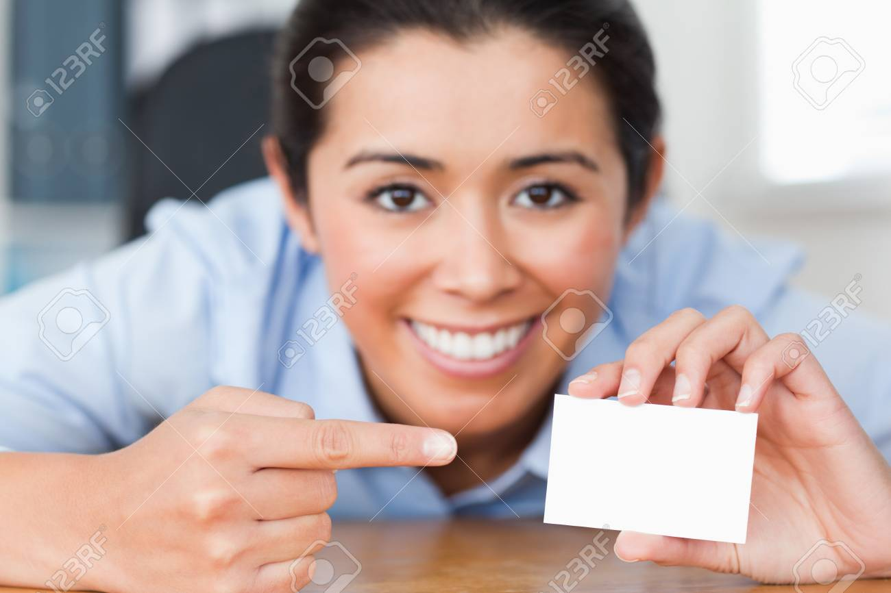Attractive woman showing her visiting card at the office Stock Photo - 11204735