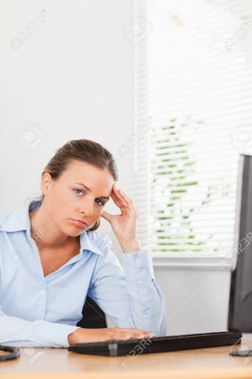 A businesswoman is holding her head in an office Stock Photo - 11201753