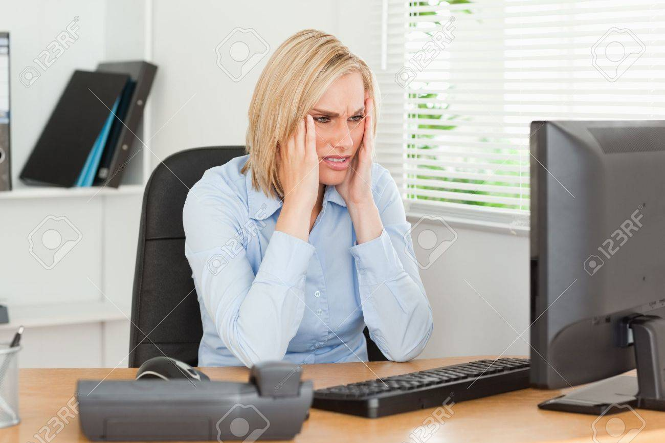 Frustrated working woman in front of a screen in an office Stock Photo - 11205932