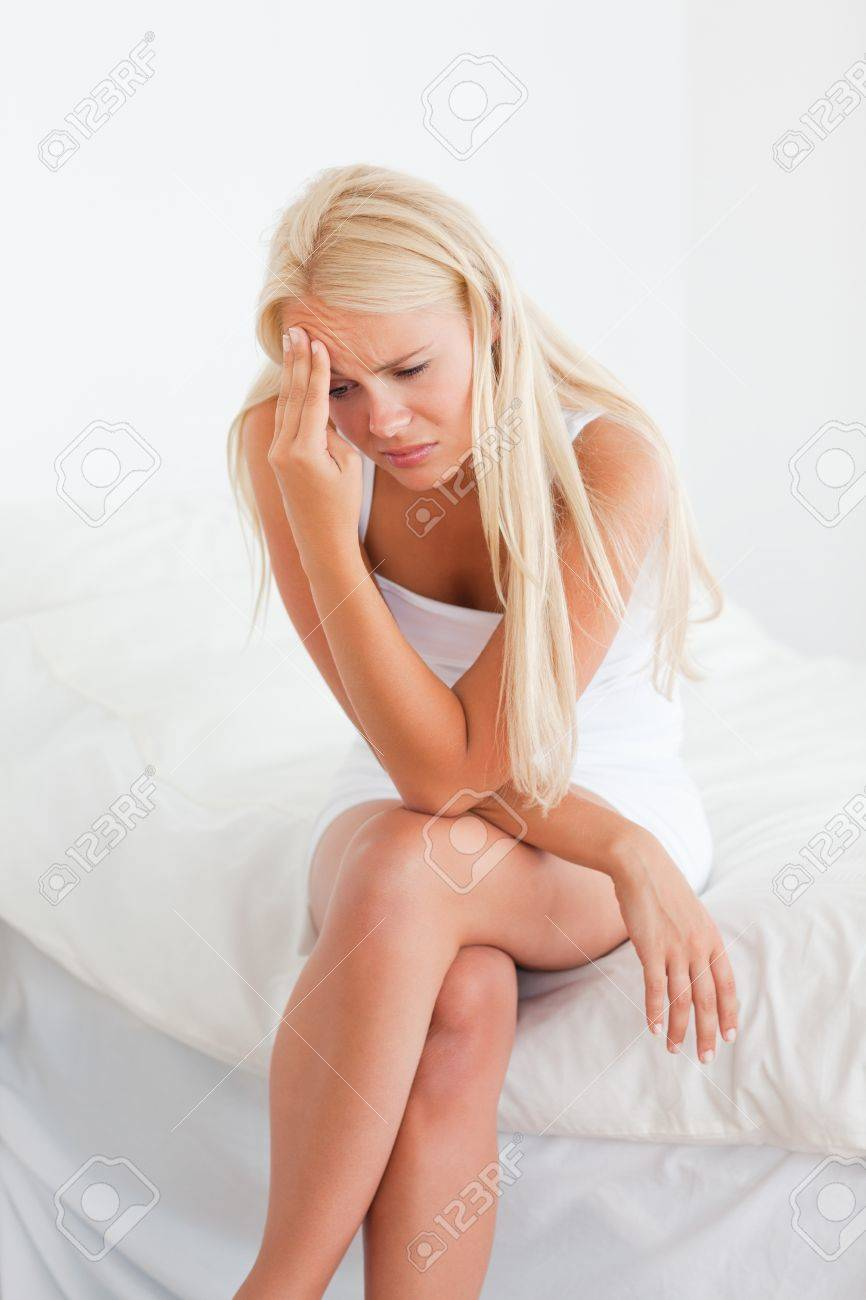 Portrait of an ill blonde woman in her bedroom Stock Photo - 11230526