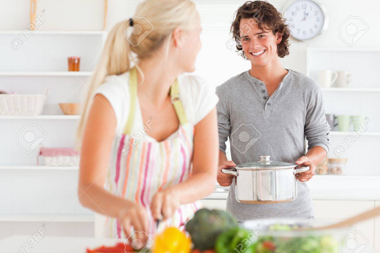 Young couple cooking in their kitchen Stock Photo - 11226939