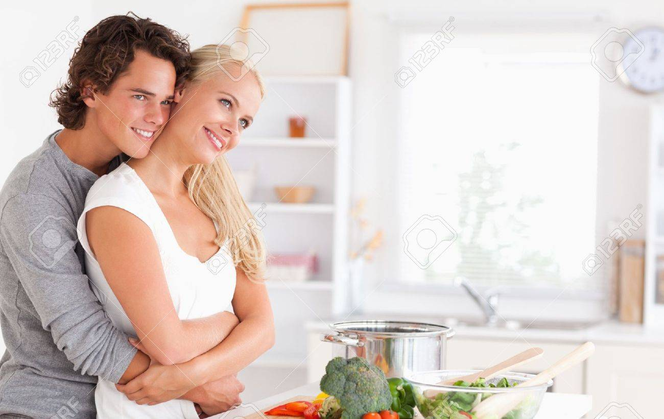 Cute couple posing in their kitchen Stock Photo - 11192115