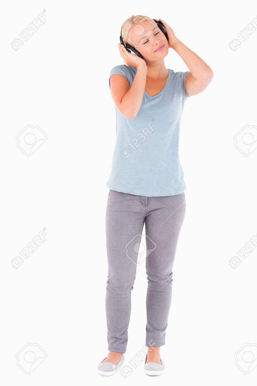 Woman with headphones having eyes closed in a studio Stock Photo - 11206408