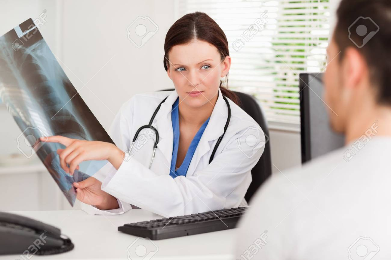A female doctor is showing her patient an x-ray Stock Photo - 11231615