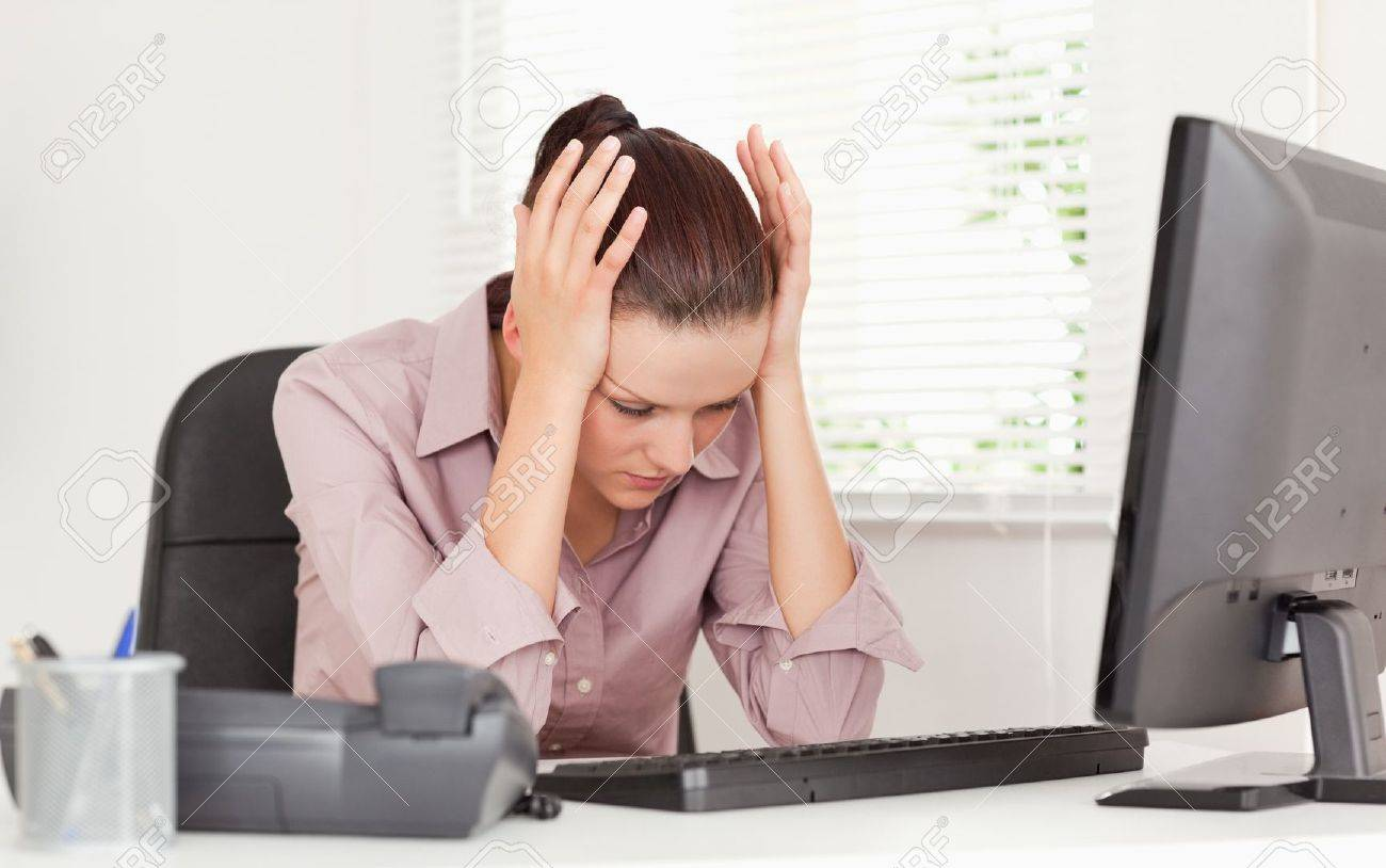 A stressed businesswoman in her office Stock Photo - 11192342