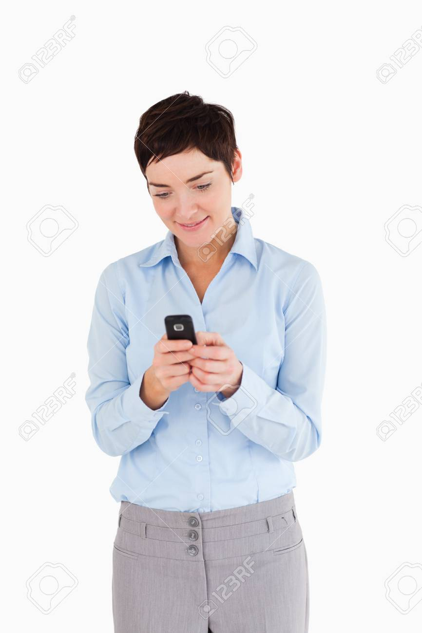 Portrait of a businesswoman sending text messages against a white background Stock Photo - 11228171