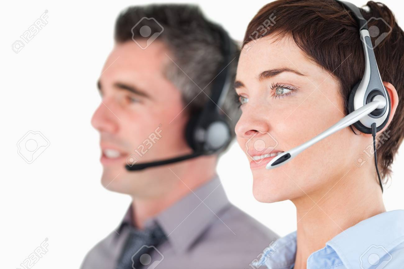 Close up of operators with headsets against a white background Stock Photo - 11213269