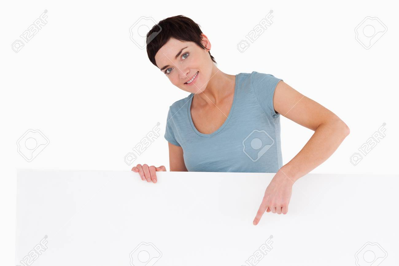 Woman pointing at something on a panel against a white background Stock Photo - 11228213