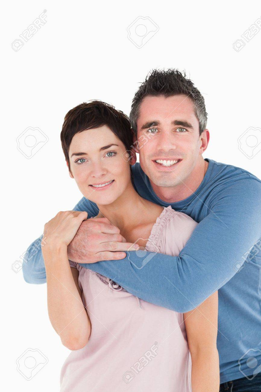 Portrait of a man embracing his wife against a white background Stock Photo - 11213048