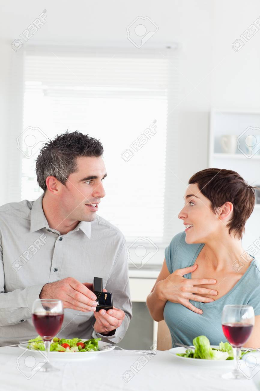 Man proposing to his cute girlfriend in a dining room Stock Photo - 11190767