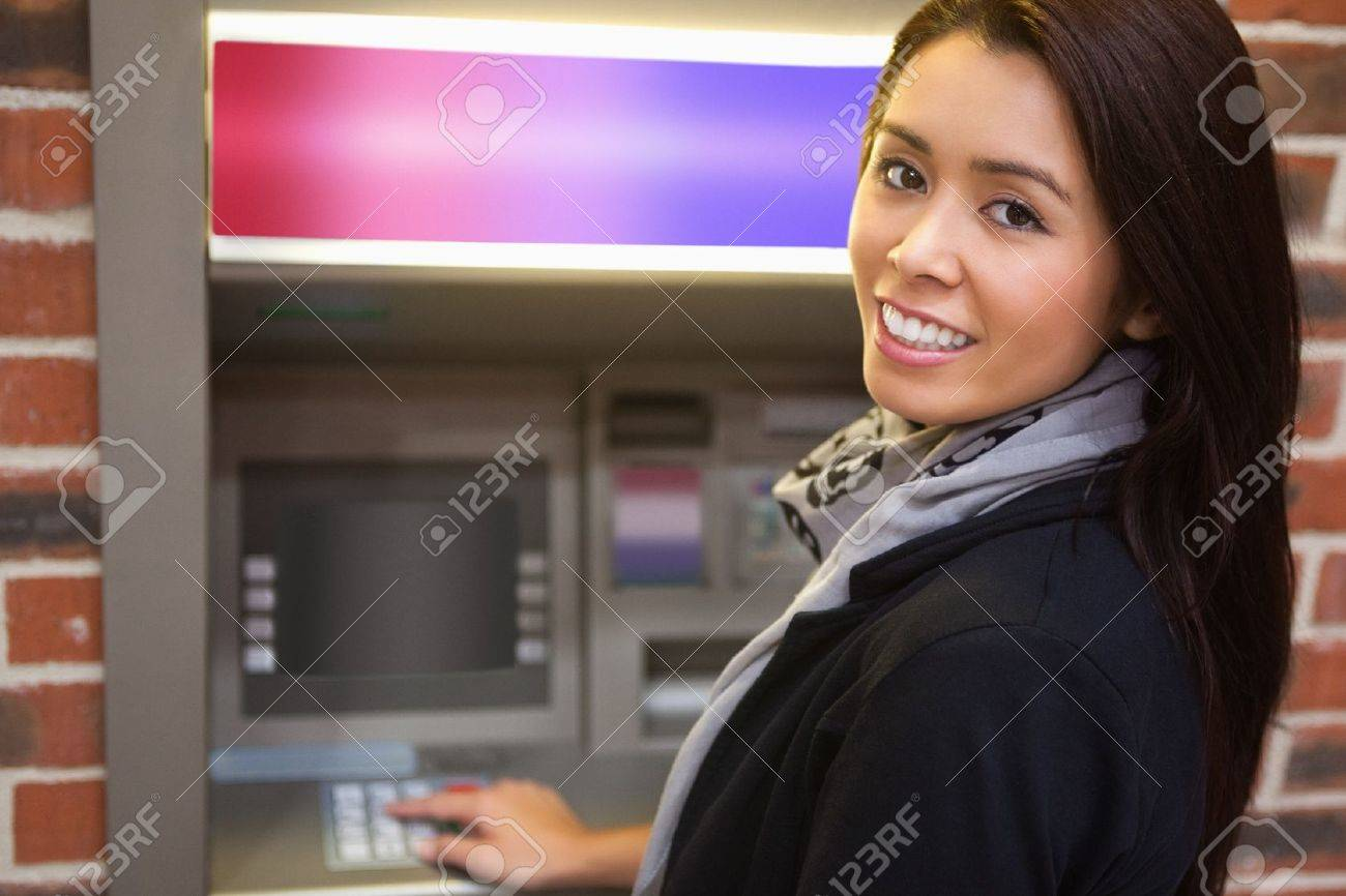 Woman withdrawing cash at an ATM Stock Photo - 11184457