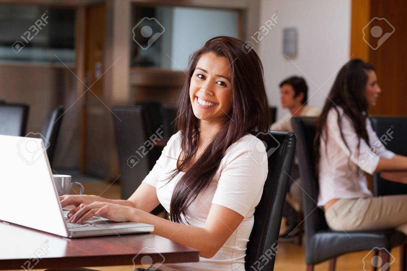 Smiling woman using a notebook in a cafe Stock Photo - 11184771