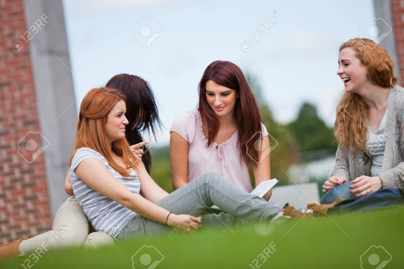 Friends having a good time while sitting on the lawn Stock Photo - 11187003