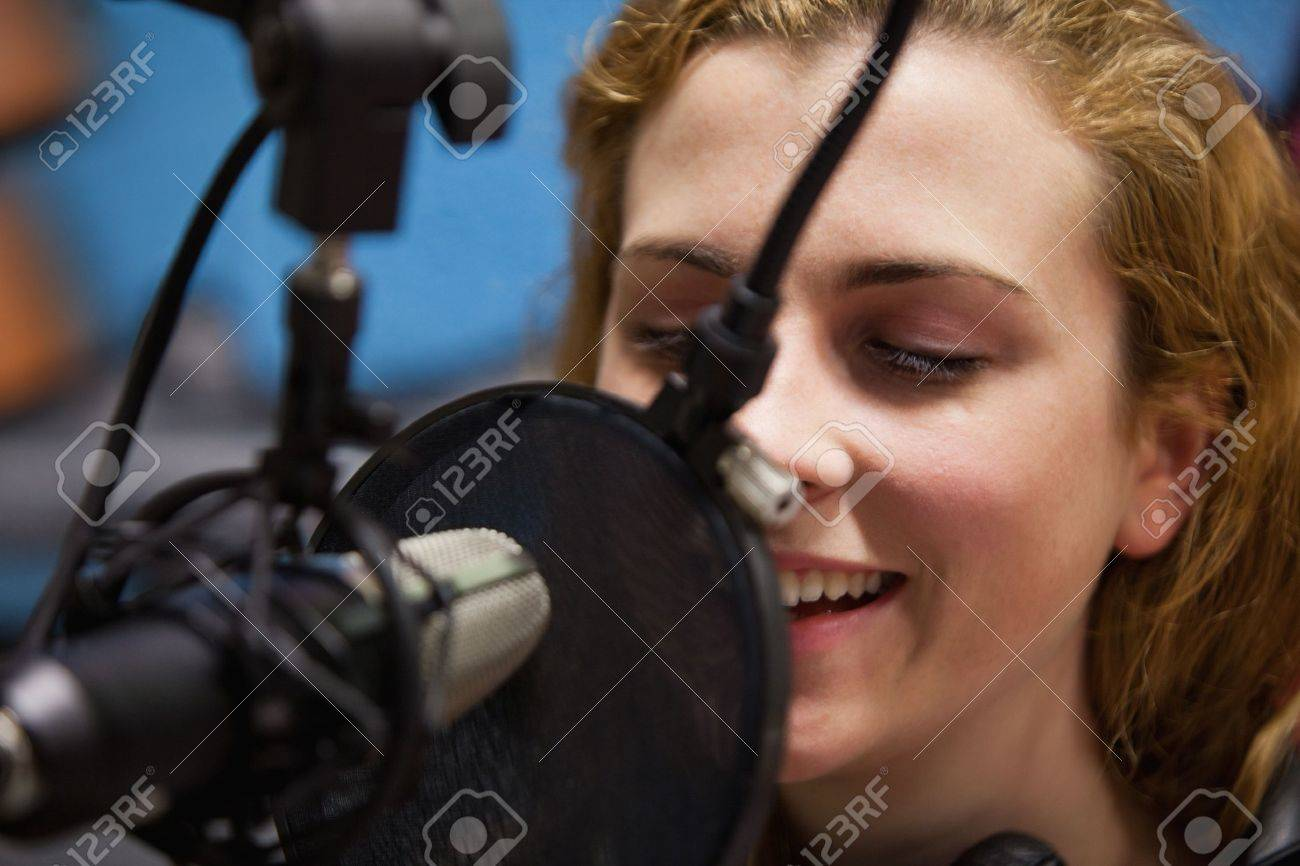 Close up of a young singer recording a track in a studio Stock Photo - 11181429