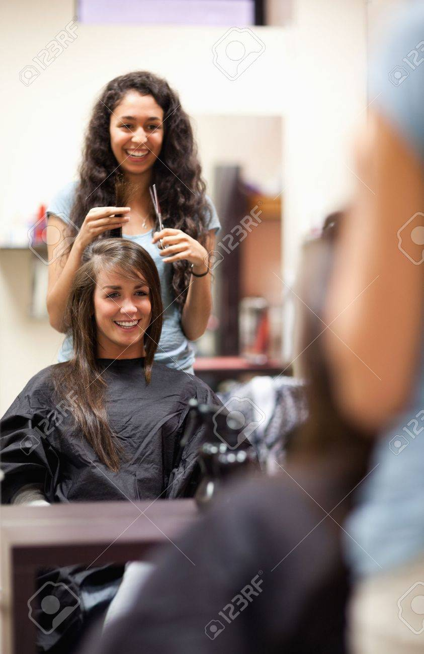 Portrait of a woman making a haircut standing up Stock Photo - 11183341