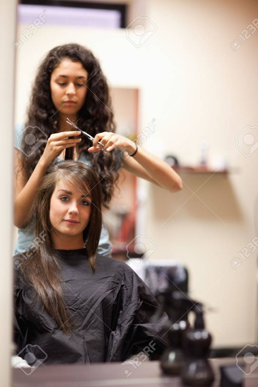 Portrait of a woman having a haircut while looking at the camera Stock Photo - 11183535