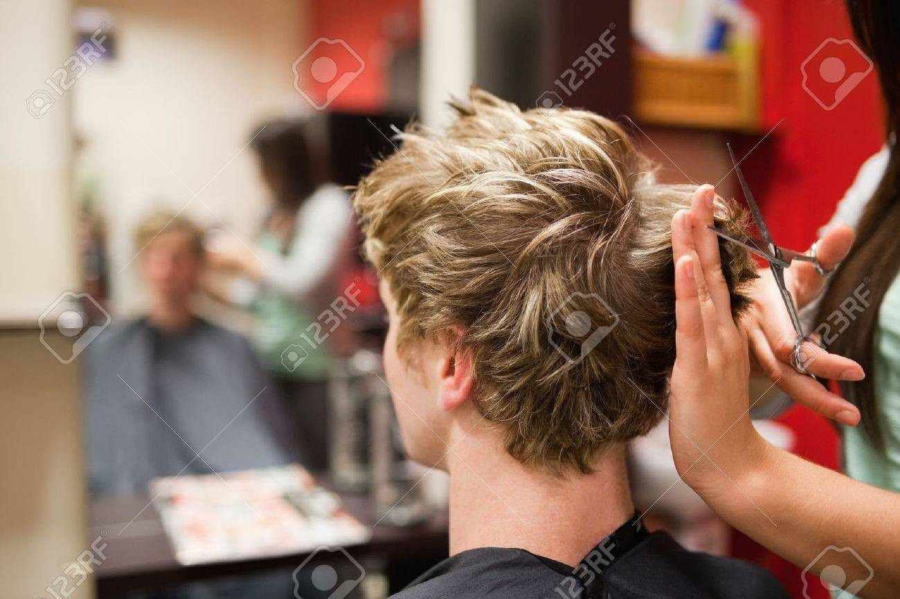 Blond Haired Man Having A Haircut With Scissors Stock Photo Picture