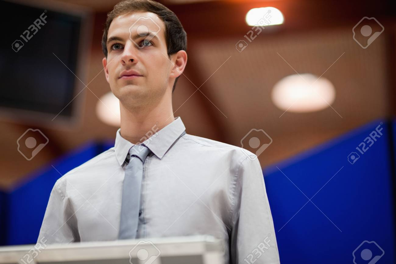 Young man doing a presentation looking away from the camera Stock Photo - 11182104