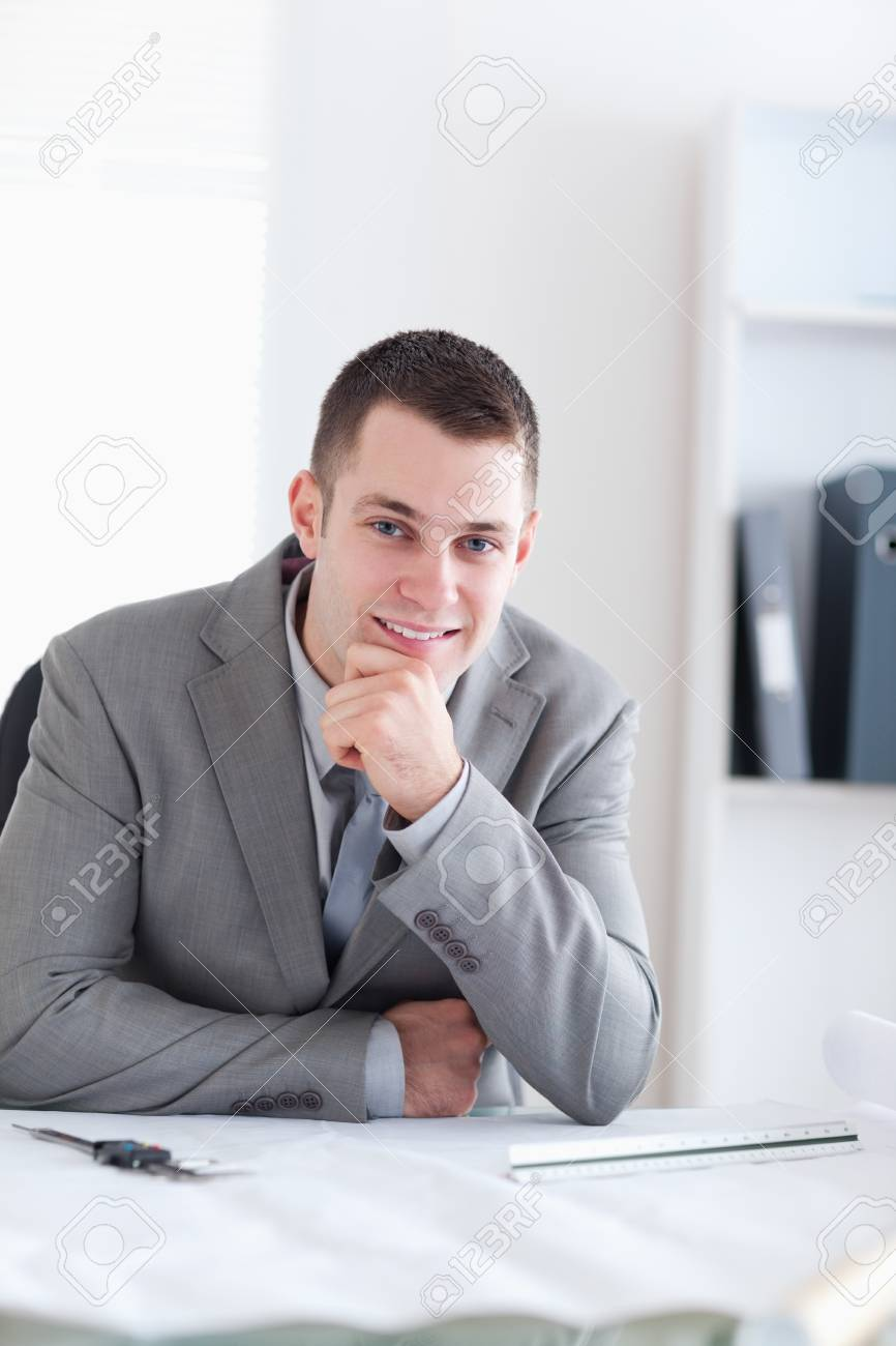Close up of smiling and thinking architect sitting behind a table Stock Photo - 11620208